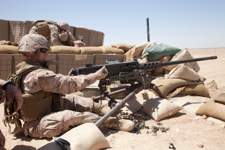 Defense.gov_News_Photo_120628-M-CV710-071_-_U.S._Marine_Corps_Cpl._Andrew_C._Bell_loads_ammunition_into_an_M2_.50-caliber_heavy_machine_gun_while_training_at_Camp_Leatherneck_in_Helmand.jpg
