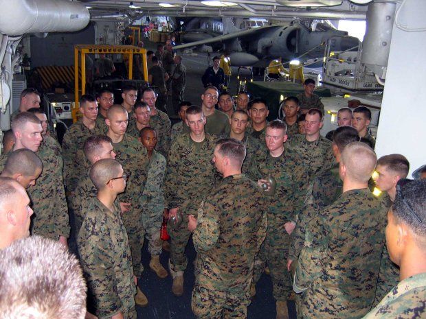 US_Navy_060219-N-4880C-003_Marines_from_the_31st_Marine_Expeditionary_Unit_(31MEU)_are_briefed_in_the_ship^rsquo,s_hangar_bay_aboard_the_amphibious_assault_ship_USS_Essex_(LHD_2),_before_going_ashore_to_assist_with_rescue_effo.jpg
